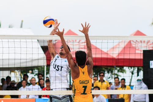 Volleyball players facing off